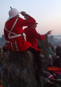 Men in Boer War uniforms atop the stones at sunrise