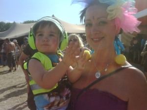 Baby wearing ear defenders claps along to music at Glastonbury